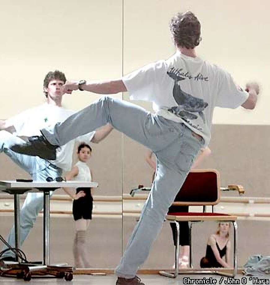 "Yuri Possokhov, with Yuan Yuan Tan in the background, prepared for his ""Magrittomania,"" a series of eight dance episodes inspired by the work of Rene Magritte. Chronicle photo by John O'Hara"
