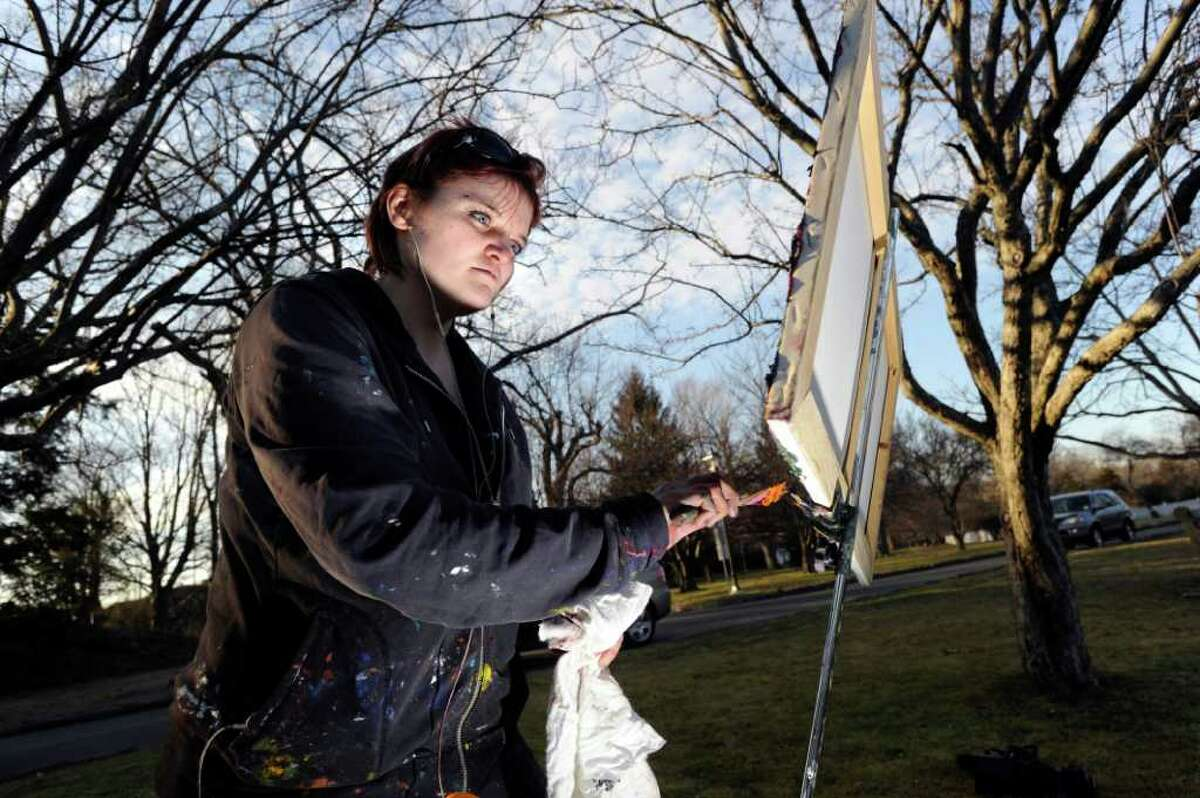 Lacey Fisher of Greenwich paints Bruce Park Pond in Greenwich on an unusually warm Tuesday afternoon, Jan. 31, 2012.