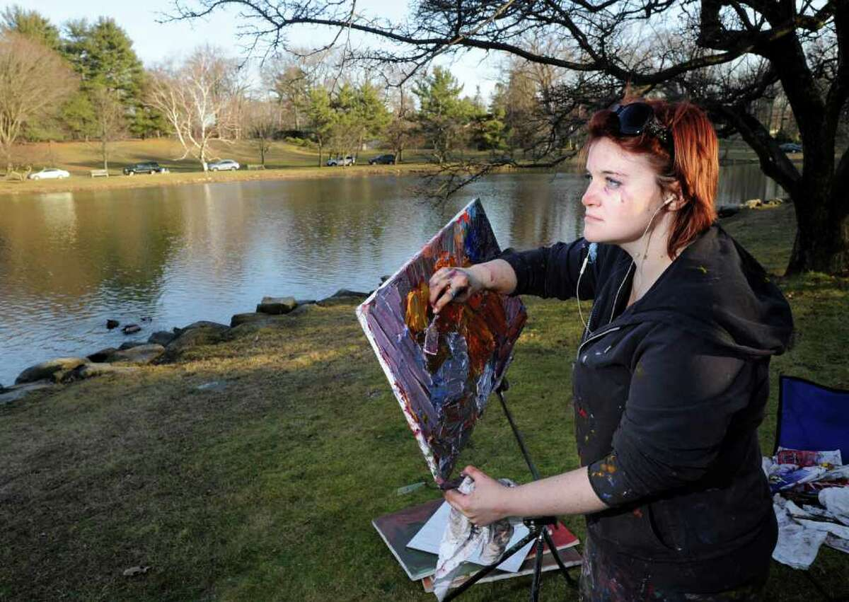 Lacey Fisher of Greenwich paints Bruce Park Pond in Greenwich on an unusally warm Tuesday afternoon, Jan. 31, 2012.