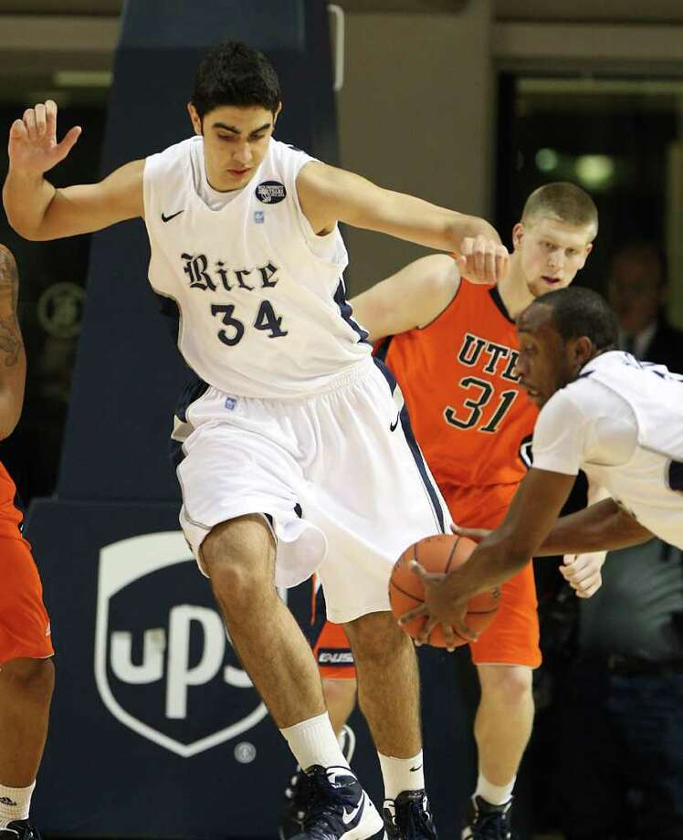 Rice's Omar Oraby (34) watches his teammate grab the rebound after fighting off  UTEP's Cedrick Lang (31) during the first half of the men's college basketball game at Tudor Fieldhouse on Wednesday, Feb. 1, 2012, in Houston. Photo: Karen Warren, Houston Chronicle / © 2012  Houston Chronicle