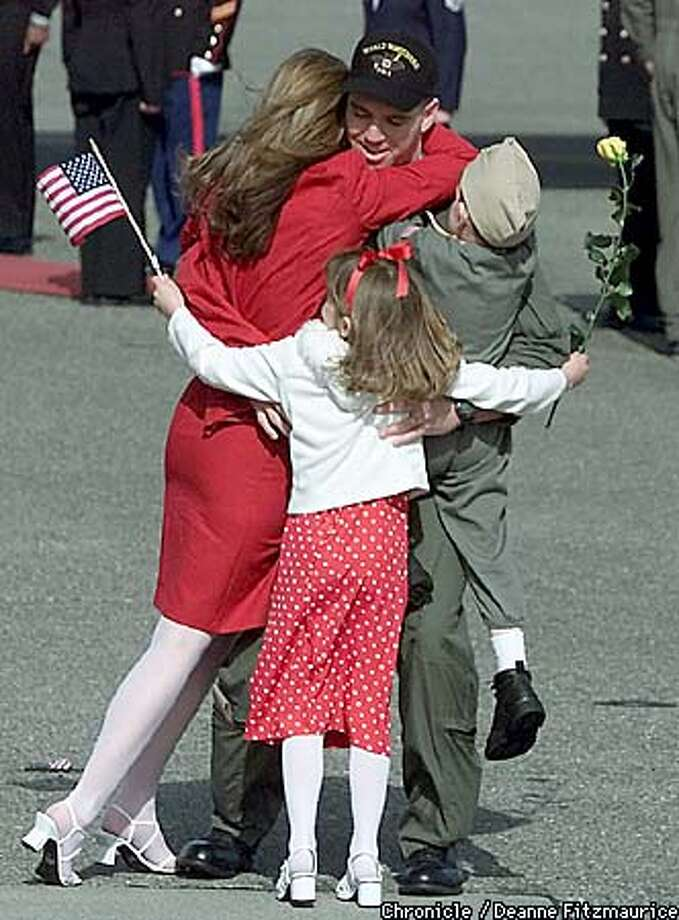 Lt. Patrick Honeck got welcoming hugs from his family. Chronicle photo by Deanne Fitzmaurice