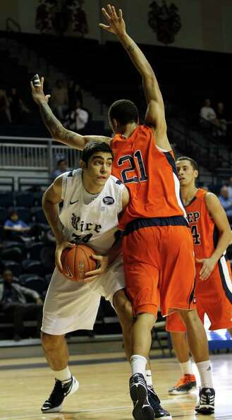 Rice's Omar Oraby (34) tries to get around the defense of UTEP's John Bohannon (21) during the first