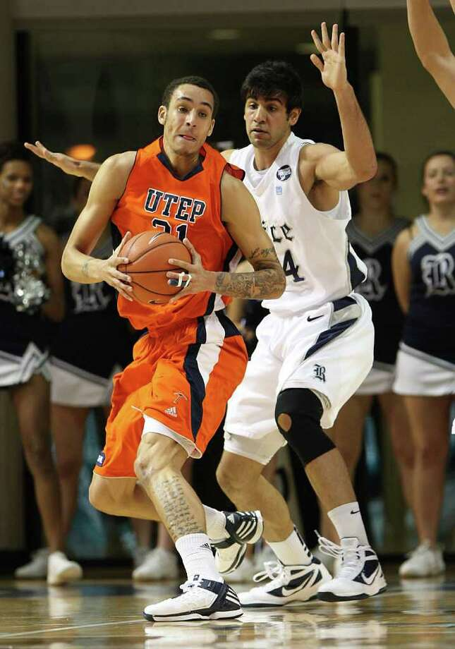 UTEP's John Bohannon (21) battles against Rice's Arsalan Kazemi (14) during the first half of the men's college basketball game at Tudor Fieldhouse on Wednesday, Feb. 1, 2012, in Houston. Photo: Karen Warren, Houston Chronicle / © 2012  Houston Chronicle