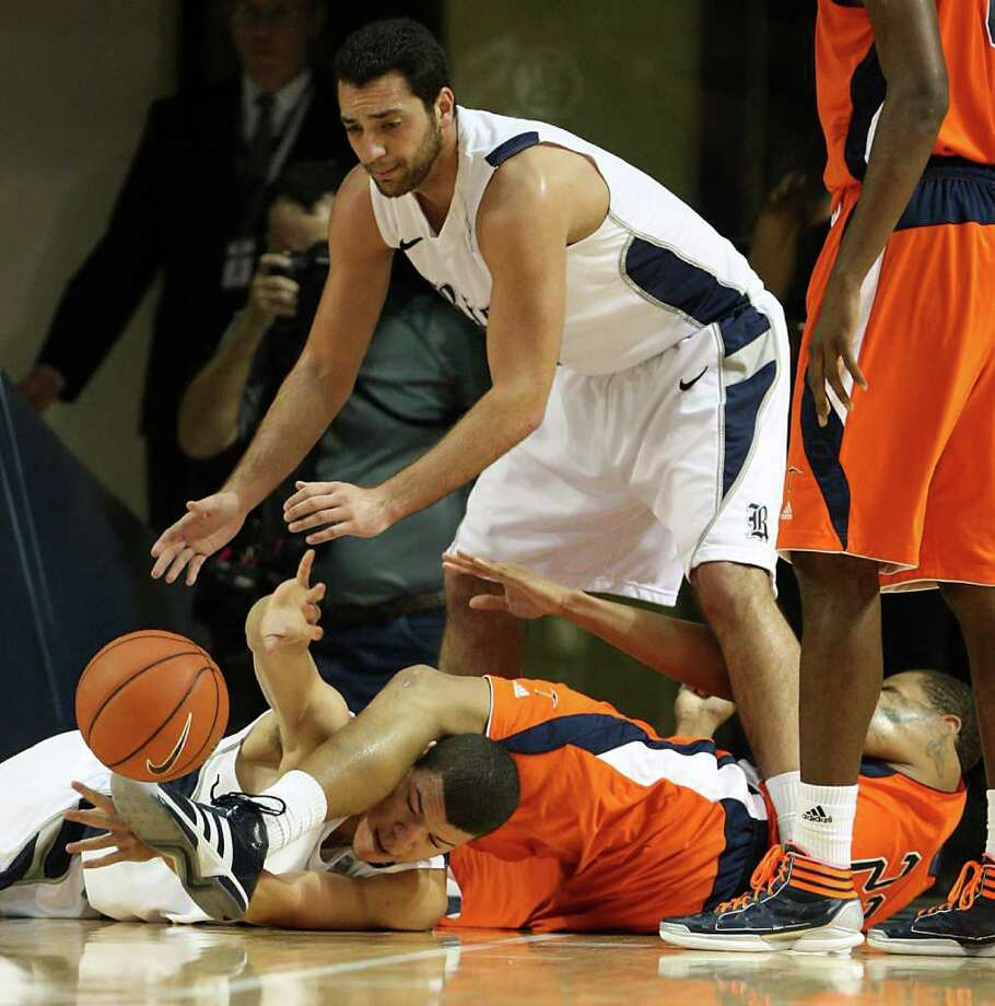 Rice's Jarelle Reischel (12) battles for a loose ball against UTEP's Gabriel McCulley (23) as Rice's Ahmad Ibrahim (0) leans in to assist during the first half of the men's college basketball game at Tudor Fieldhouse on Wednesday, Feb. 1, 2012, in Houston. Photo: Karen Warren, Houston Chronicle / © 2012  Houston Chronicle