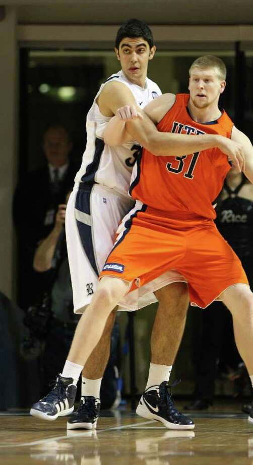 Rice's Omar Oraby (34) covers UTEP's Cedrick Lang (31) during the first half of the men's college basketball game at Tudor Fieldhouse on Wednesday, Feb. 1, 2012, in Houston. Photo: Karen Warren, Houston Chronicle / © 2012  Houston Chronicle