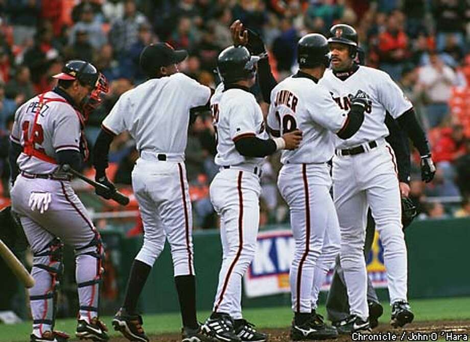 "San Francisco, ""3 Com Park""  Giants V/s Braves. Giants Ellis Burks, hit a home run with two men on base. being greeted M. Bernard and S. Javier  Photo by........John O'Hara Photo: John O'Hara"