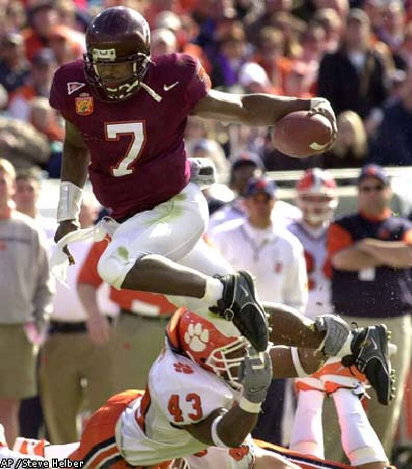 The San Diego Chargers are making it pretty clear that Virginia Tech quarterback Michael Vick will be their first pick in the NFL draft. Associated Press photo by Steve Helber
