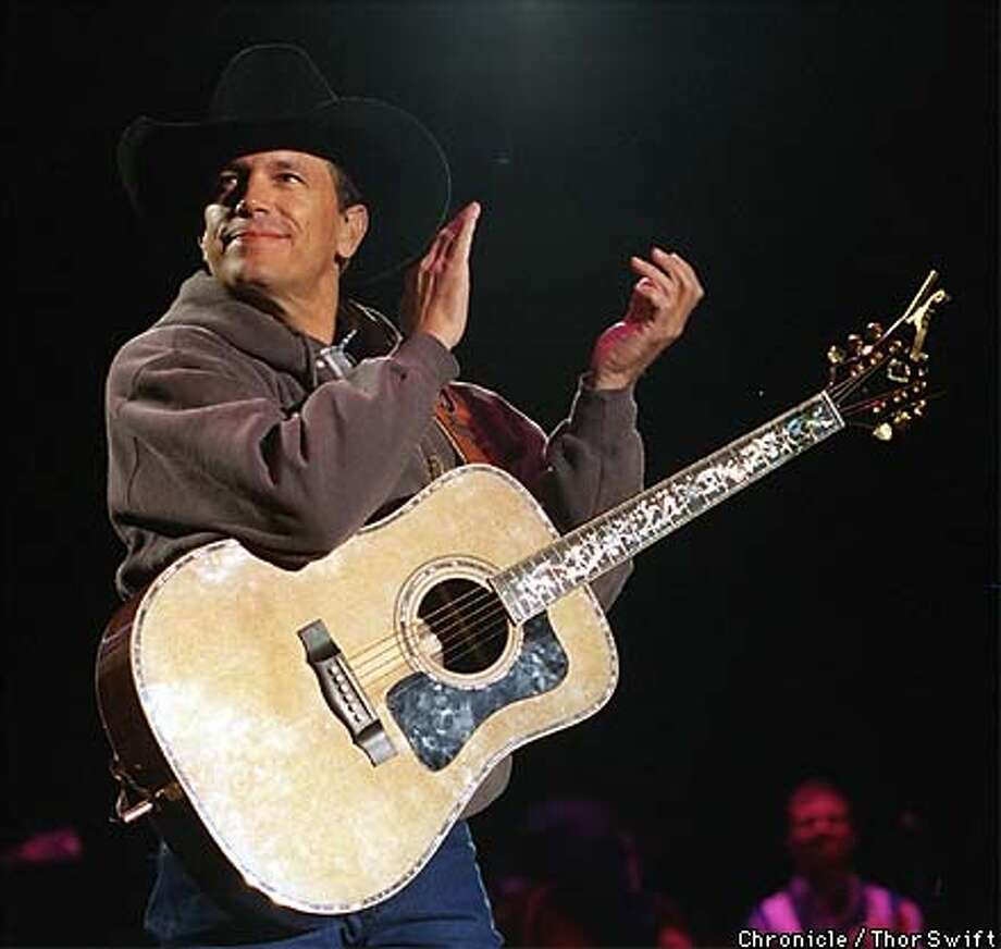 George Strait performed at the Oakland Coliseum Sunday night.  BY THOR SWIFT/FOR THE CHRONICLE; ONE-TIME USE ONLY Photo: THOR SWIFT