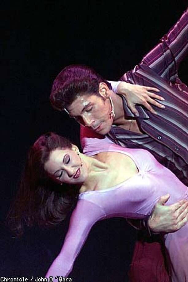 """Richard Blake and Jeanine Meyers play the disco king and queen of """"Saturday Night Fever,"""" at the Orpheum Theatre. Chronicle photo by John O'Hara"""