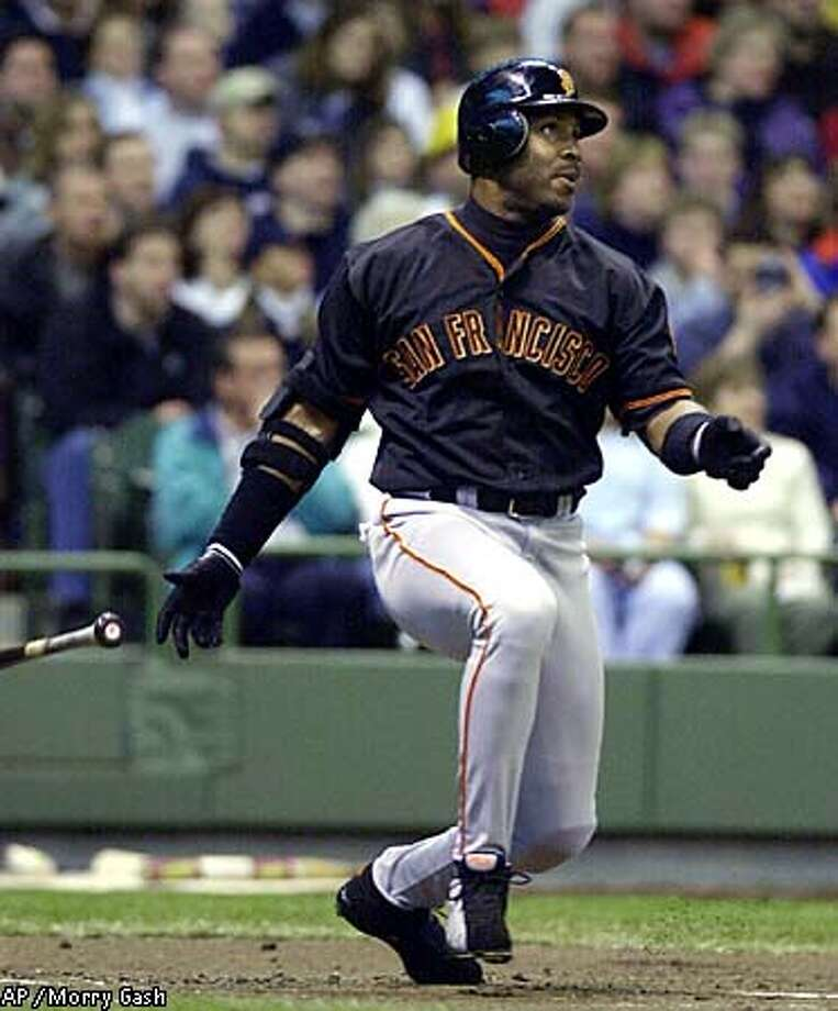 Barry Bonds hit homer No. 497 off Brewers pitcher Jamey Wright in the first inning. Associated Press photo by Morry Gash