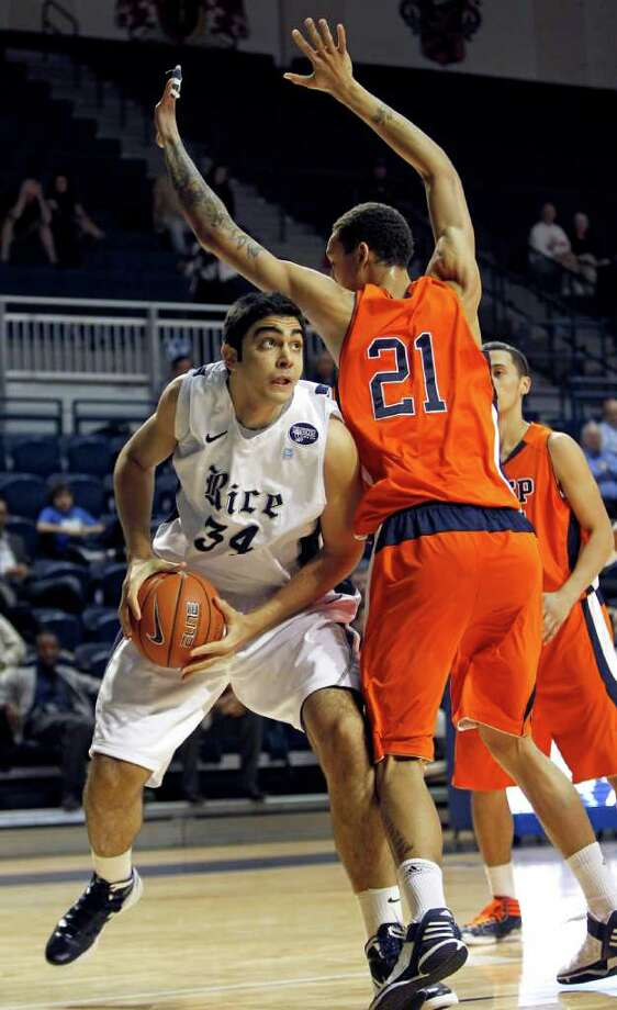 Rice's Omar Oraby (34) tries to get around UTEP's John Bohannon (21) during the first half of an NCAA college basketball game between Rice and UTEP on Wednesday, Feb. 1, 2012, in Houston. (AP Photo/Houston Chronicle, Karen Warren) MANDATORY CREDIT Photo: Karen Warren, Associated Press / © 2012  Houston Chronicle