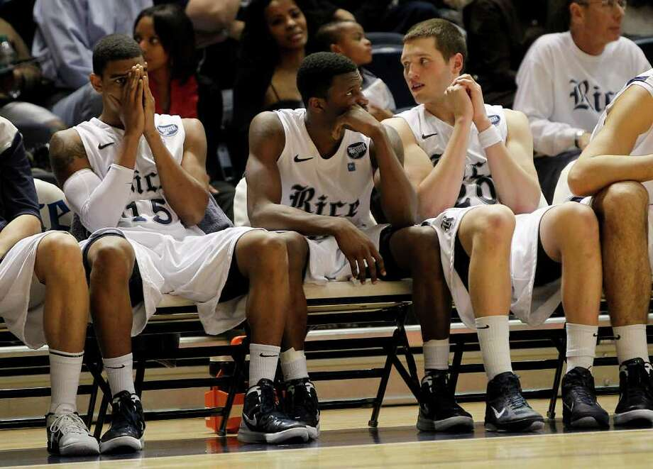 Rice's Julian DeBose (15, left) can barely watch in the last minute of play, however he beat the buzzer with the winning basket in the final seconds during the second half of the men's college basketball game at Tudor Fieldhouse on Wednesday, Feb. 1, 2012, in Houston.  Rice Owls won the game 77-75 against UTEP. Photo: Karen Warren, Houston Chronicle / © 2012  Houston Chronicle