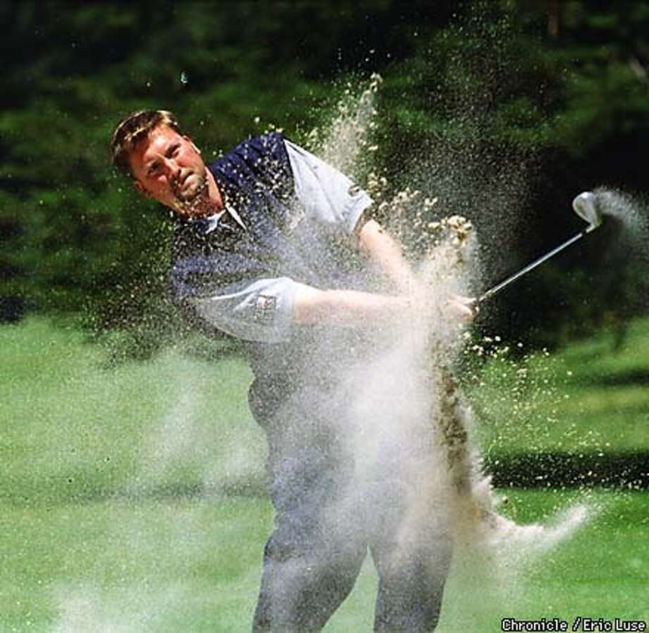 Pete Anderson drives one out of a sand pit on the 6th green.  BY ERIC LUSE/THE CHRONICLE Photo: ERIC LUSE