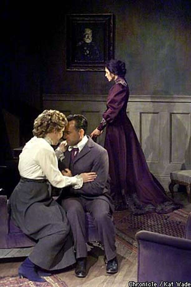 """The unhappy housewife Hedda Gabler (Stacy Ross) steadies herself as Thea Elvsted (Beth Donohue) and Eilert Lovborg (Marvin Greene) share a special moment in Aurora Theatre Company's """"Hedda Gabler."""" Chronicle photo by Kat Wade"""