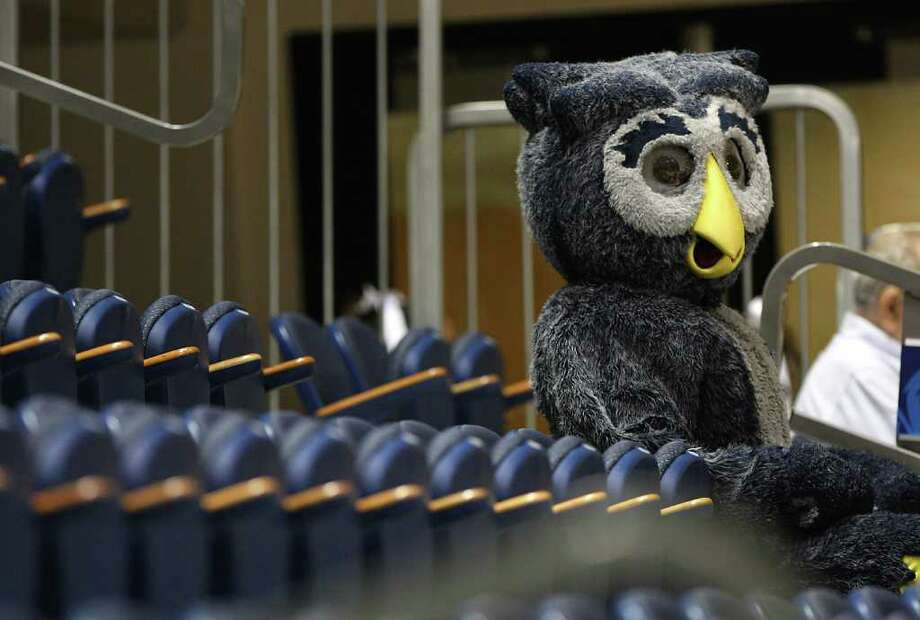 The Rice Owl sits in the stands before the start of the first half of the men's college basketball game at Tudor Fieldhouse in Houston. Photo: Karen Warren, Houston Chronicle / © 2012  Houston Chronicle