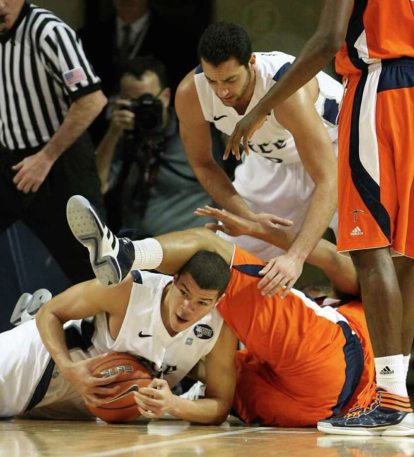 Rice's Jarelle Reischel (12) battles for a loose ball against UTEP's Gabriel McCulley (23) as Rice's Ahmad Ibrahim (0) leans in to assist during the first half of the men's college basketball game at Tudor Fieldhouse in Houston. Photo: Karen Warren, Houston Chronicle / © 2012  Houston Chronicle