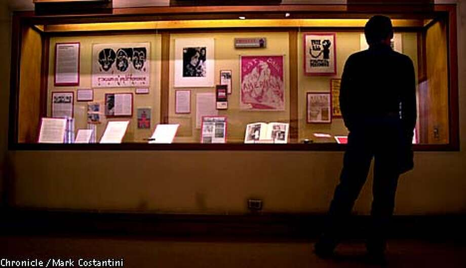 Tim Karas paused for a moment to review the memorabilia of an era at UC Berkeley. Chronicle photo by Mark Costantini