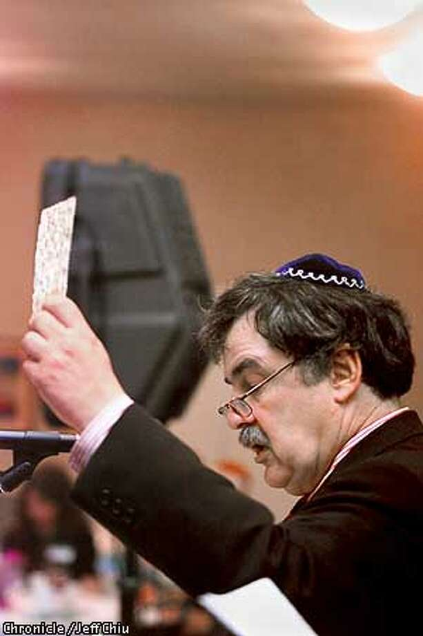 Rabbi Steven Chester presides over the Freedom Seder, which welcomes people of all faiths. Chronicle photo by Jeff Chiu