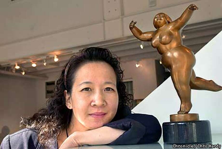 """Barbara Chen has been making her pleasingly plump figures for six years, and chooses their names -- """"Felicity,"""" """"Allegra,"""" """"Minuet"""" -- from a variety of music. Chronicle photo by Chris Hardy"""
