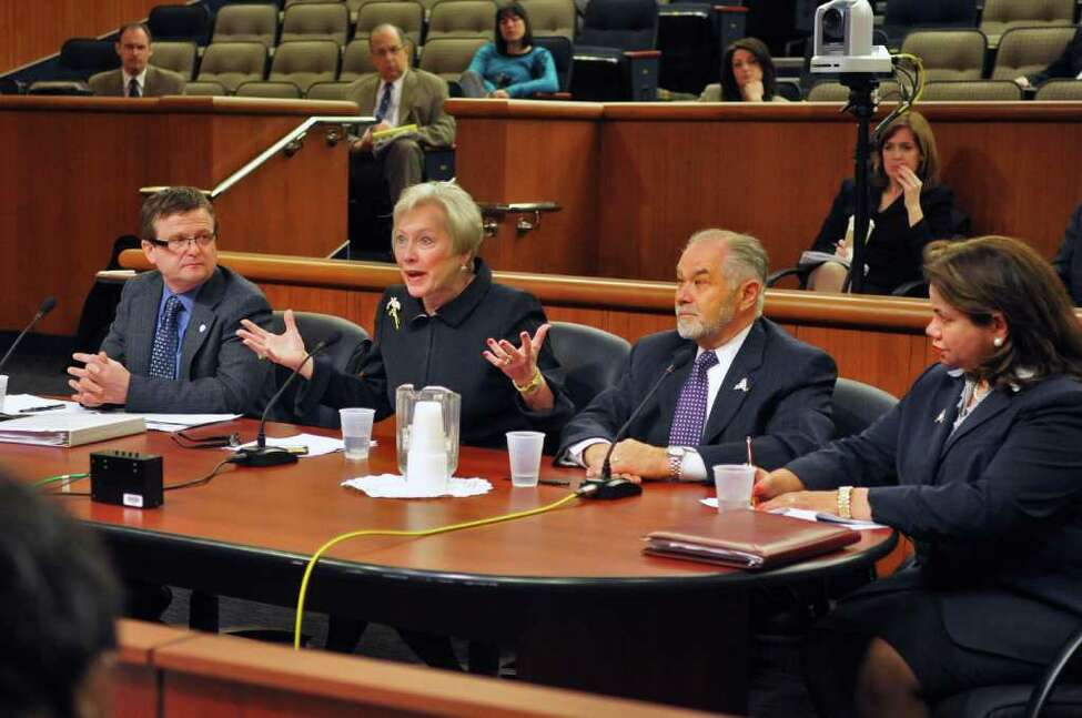 SUNY officials (from left) CFO Brian Hutzley, chancellor Nancy Zimpher, vice chancellor and senior vice chancellor Johanna Duncan-Poitier provost David LaValle testify before a NYS Legislative joint budget hearing on higher education in Albany Wednesday Feb. 1, 2012. (John Carl D'Annibale / Times Union)