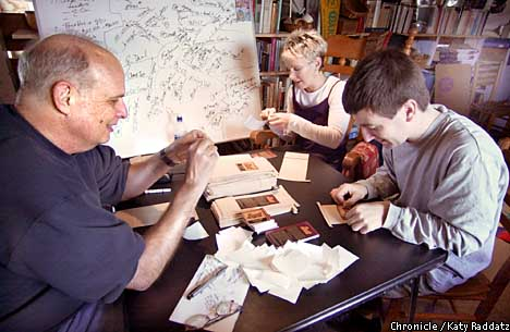 Lee Thorn with helpers Theresa Kingston and Damon Styer paste labels on coffee bags. Chronicle photo by Katy Raddatz