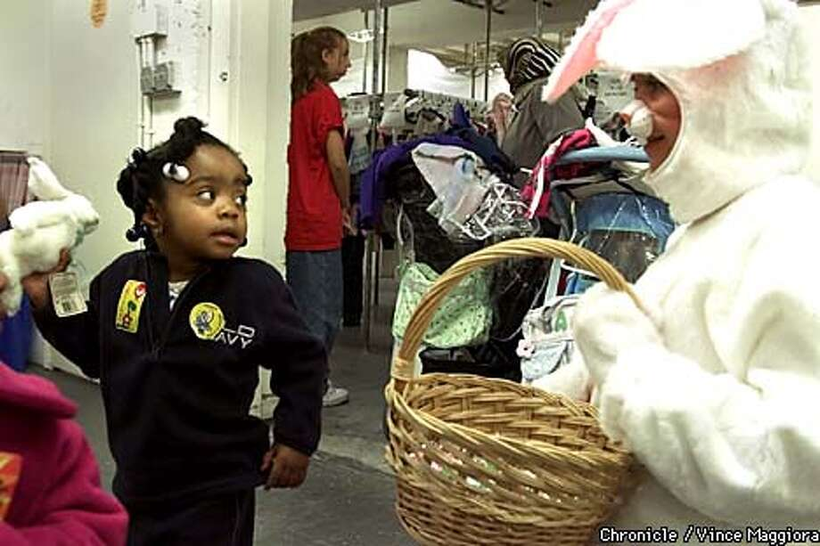 Two-year-old Imani Williams eyed the Easter bunny at the giveaway. Chronicle photo by Vince Maggiora
