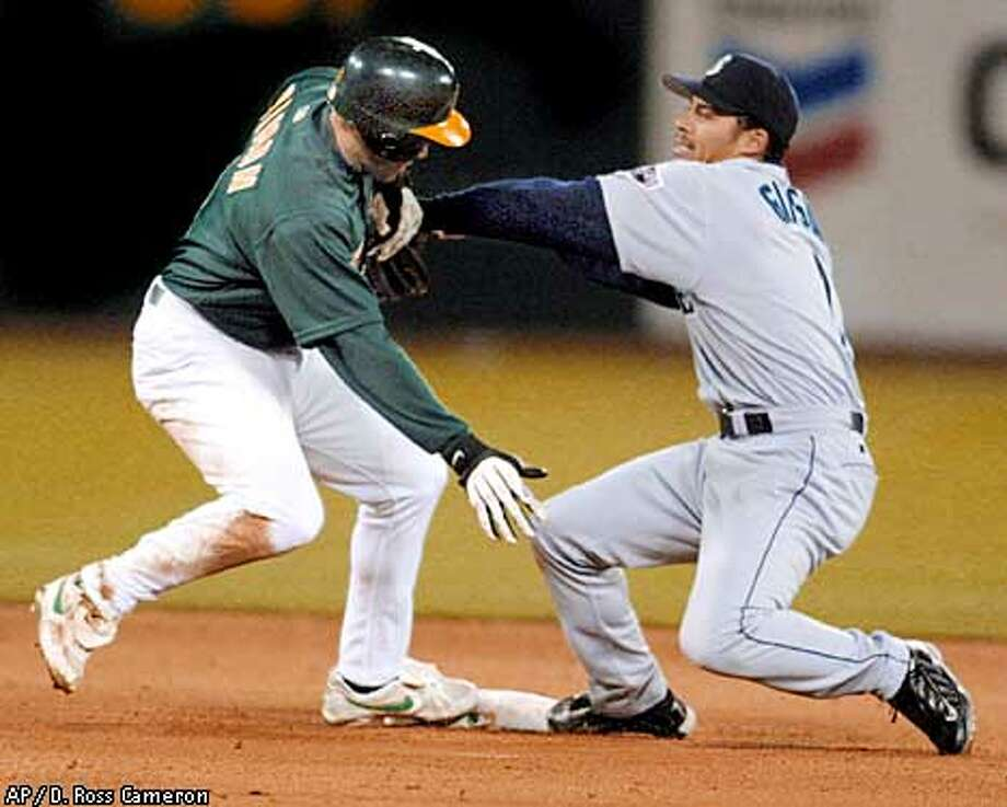 Mariners shortstop Charles Gipson Jr. tags out Johnny Damon on an attempted steal of second to end the sixth inning. Associated Press photo by D. Ross Cameron