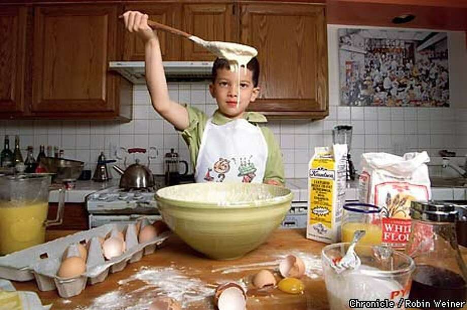Tim Webber, 5, gets into the holiday spirit by whipping up pancake batter. Chronicle Photo Illustration by Robin Weiner