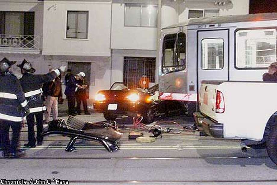 Police say a car passenger died when a drag-racer hit a Muni car. Chronicle photo by John O'Hara