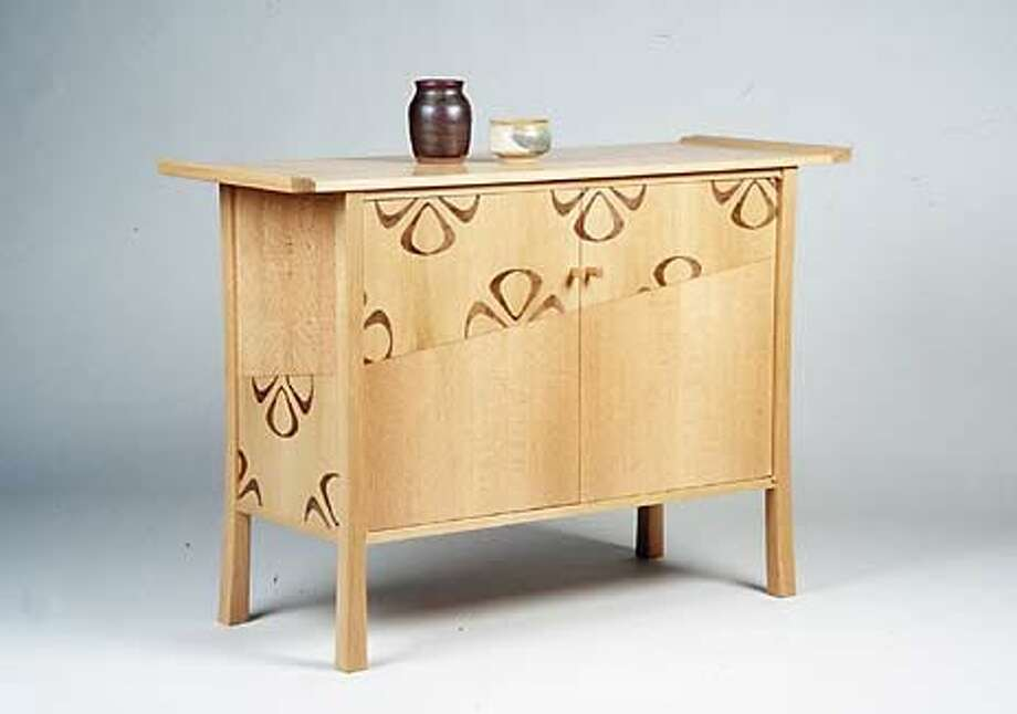 Seth Janofsky of Fort Bragg created this buffet cabinet with band-sawn veneers of oak in floral motifs.