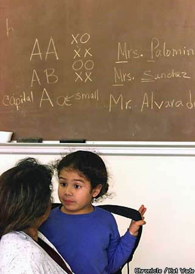 Stephanie Sanchez discussed her after-school plans with her mother, Maria Consuelo Sanchez, in an English class at Parkside Elementary in Pittsburg. Chronicle Photo by Kat Wade