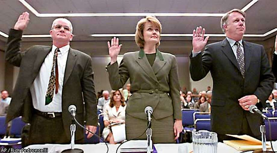 Federal Energy Commission General Counsel Kevin Madden, left, Public Utilities Commission President Loretta Lynch, center, and California Independent System Operator President and Chief Executive Officer Terry Winter, raise their right hands as they are sworn-in before testifying before a congressional subcommittee hearing held in Sacramento, Calif., Tuesday, April 10, 2001. The Energy Policy and Regulatory Affairs Subcommittee of the House Government Reform Committee, held the hearing to look into California's energy problems. (AP Photo/Rich Pedroncelli) Photo: RICH PEDRONCELLI