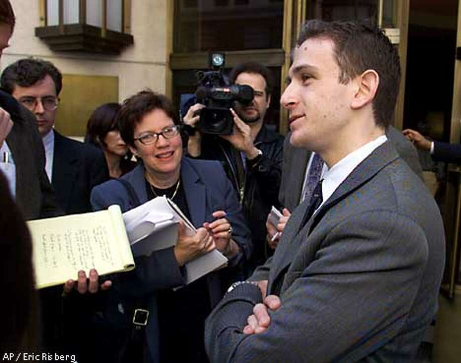 Brian Hermann, right, an attorney with the California Public Utilities Commission, answers questions outside U.S. Bankruptcy Court in San Francisco, Tuesday, April 10, 2001. Federal bankruptcy Judge Dennis Montali told Pacific Gas and Electric Co. it has nine extra days to show the PUC its plan for paying back the state for power buys. (AP Photo/Eric Risberg) Photo: ERIC RISBERG