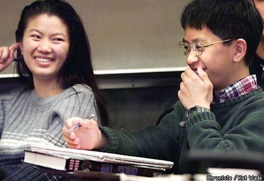 Twelve-year-old graduating Los Medanos College student, Andrew Tan shares a giggle with Dan Thanh Le, 18, during a discussion about psycological sexual disorders during professor Nat DeAnda's General Psycology class at the junior college in Pittsburg. After graduation Tan will be attending U C Davis. SAN FRANCISCO CHRONICLE PHOTO BY KAT WADE Photo: KAT WADE