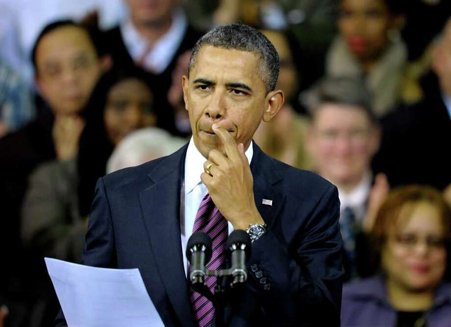 """President Barack Obama, speaking Wednesday in Falls Church, Va., is proposing more help for Americans who are """"underwater"""" on their home mortgages. Photo: Cliff Owen / FR170079 AP"""