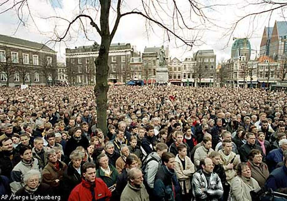 Ten thousands protesters demonstrate outside Dutch government buildings as the Upper House of Parliament debates the legalization of euthanasia at The Hague, Netherlands Tuesday April 10, 2001. (AP Photo/Serge Ligtenberg) Photo: SERGE LIGTENBERG