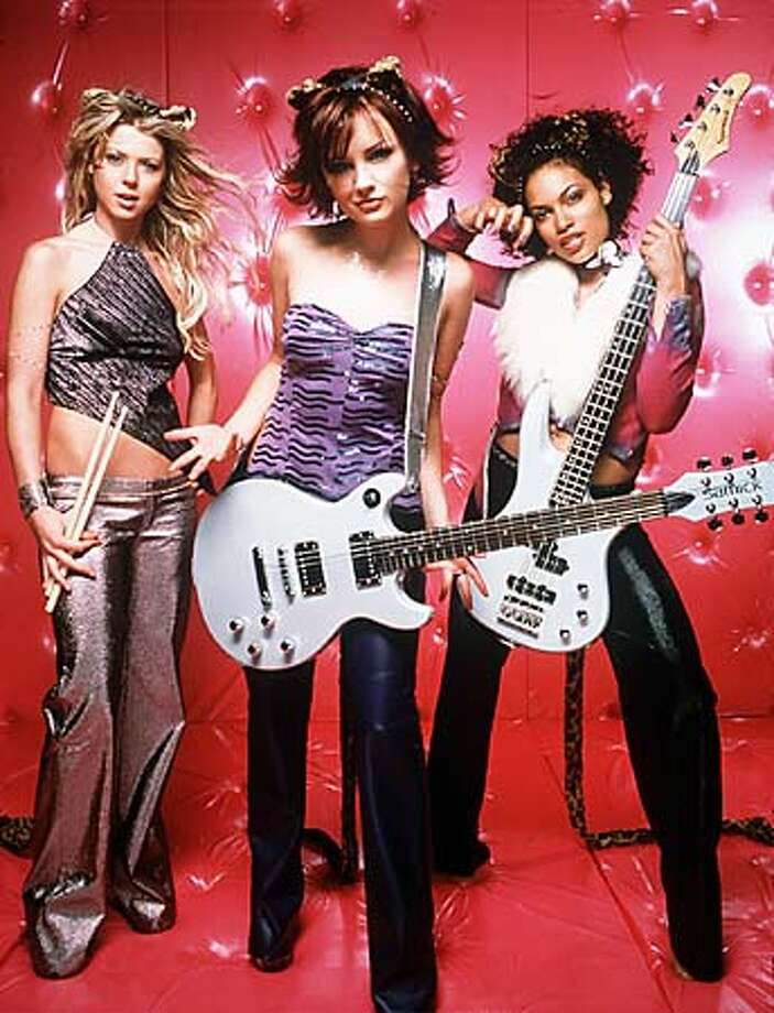 """Tara Reid, Rachael Leigh Cook and Rosario Dawson (from left) in """"Josie and the Pussycats."""" Handout Photo"""