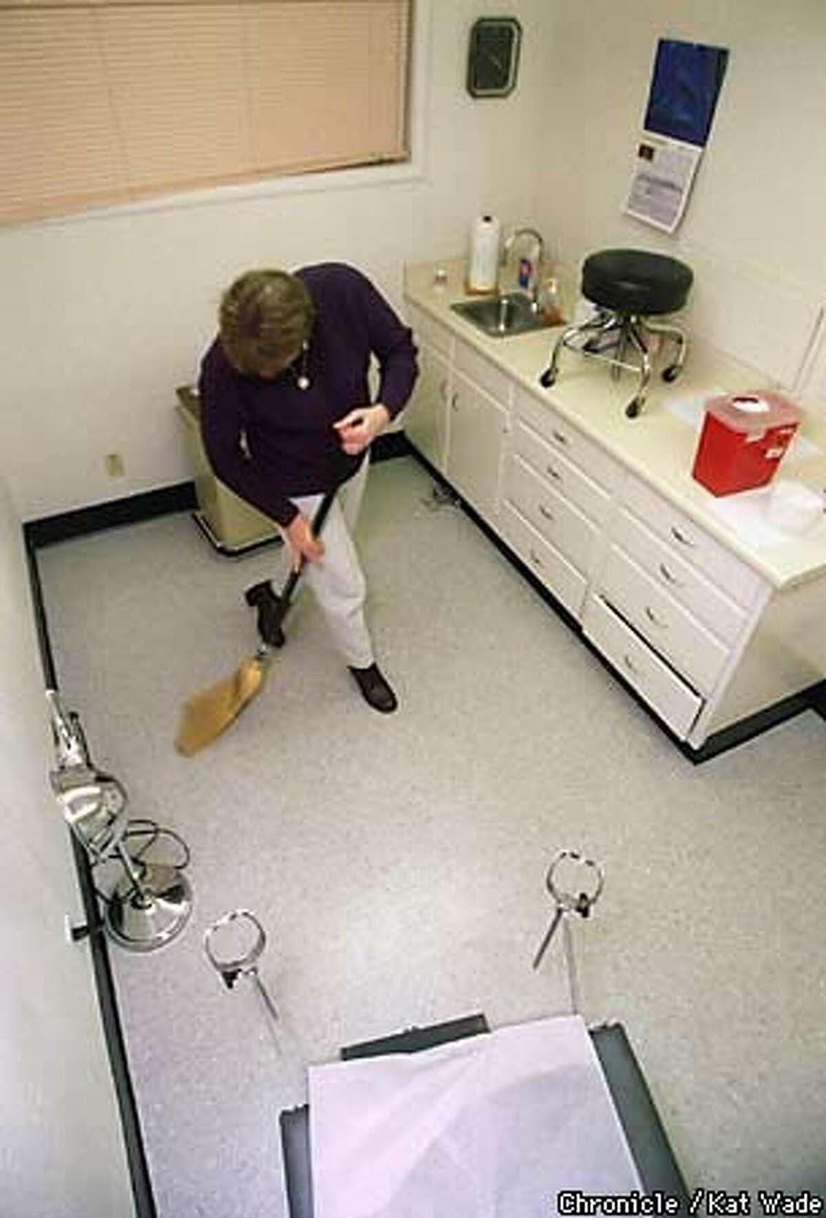 A health care worker cleaned up after abortion screening day at the Women's Health Specialists Clinic in Redding. Chronicle Photo by Kat Wade