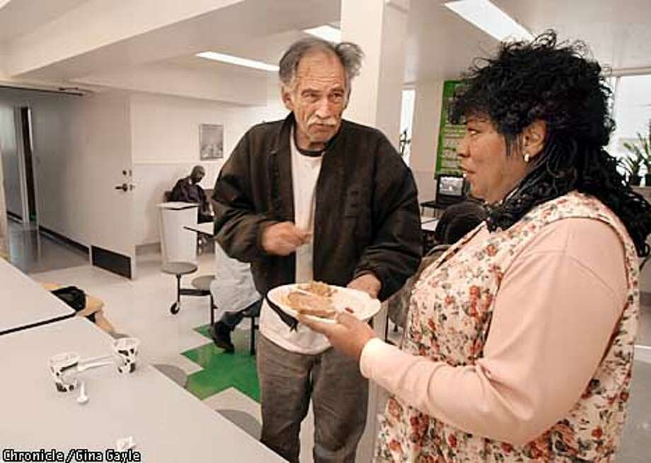 Mother Brown takes a plate from client after he finished breakfast at the Bayview Hope Homeless Resource Center on a recent morning after the center's grand opening. Photo by Gina Gayle/The SF Chronicle. Photo: GINA GAYLE