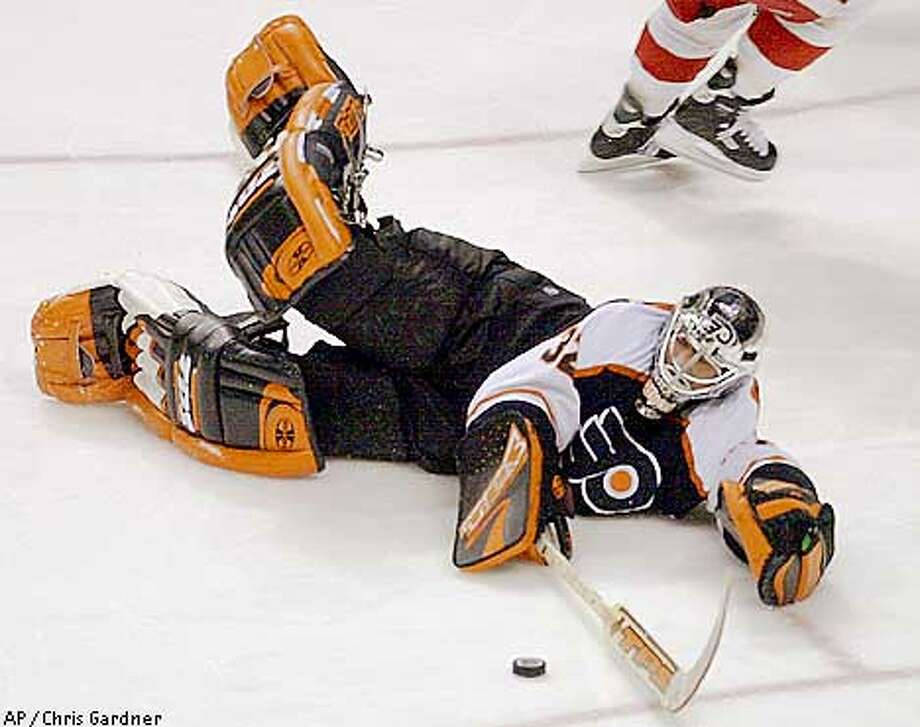 Philadelphia Flyers goalie Roman Cechmanek makes a diving save outside his crease during the second period against the Detroit Red Wings, Saturday, March 31, 2001, in Philadelphia. Cechmanek earned his 10th shutout of the season in the Flyers 1-0 win.(AP Photo/Chris Gardner) Photo: CHRIS GARDNER
