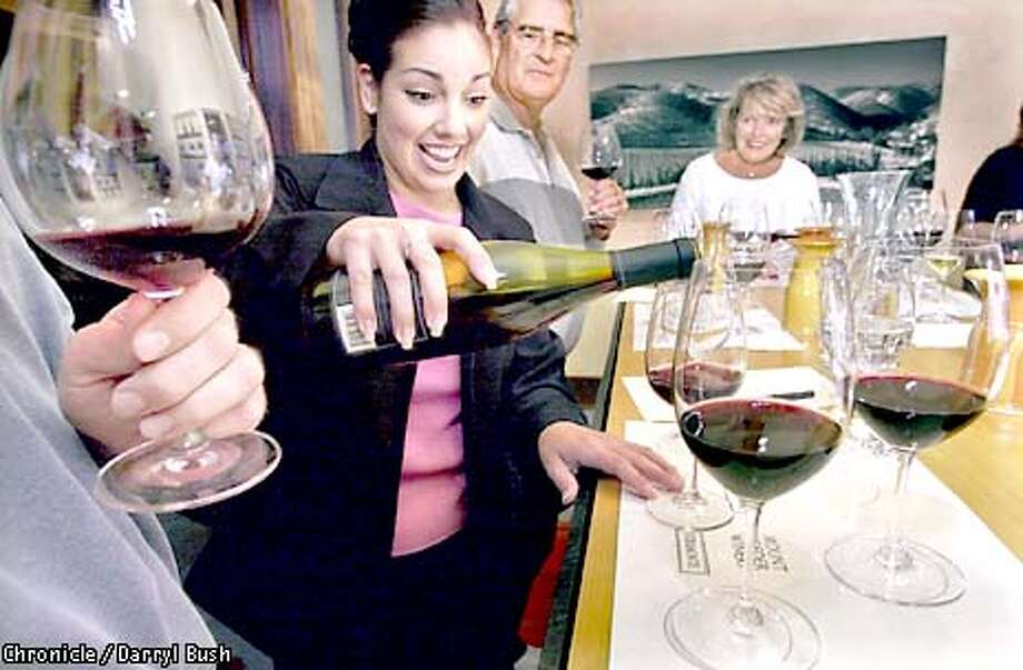 At Franciscan Oakville Estate, wine guide Kim Evans conducts a tasting for tourists from Florida.  Chronicle photo by Darryl Bush