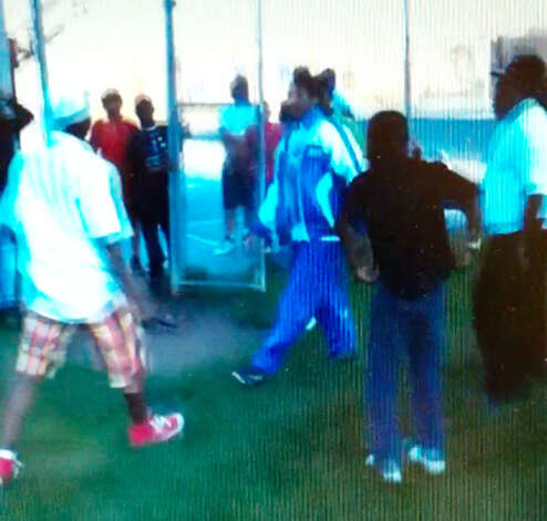 Frame grab from cellphone video showing Jah-Lah Vanderhorst, left, and Tyler Rhodes, right, during a knife fight last year in Hoffman Park. Rhodes died from stab wounds he sustained during the Albany fight. (Albany County Court evidence video)