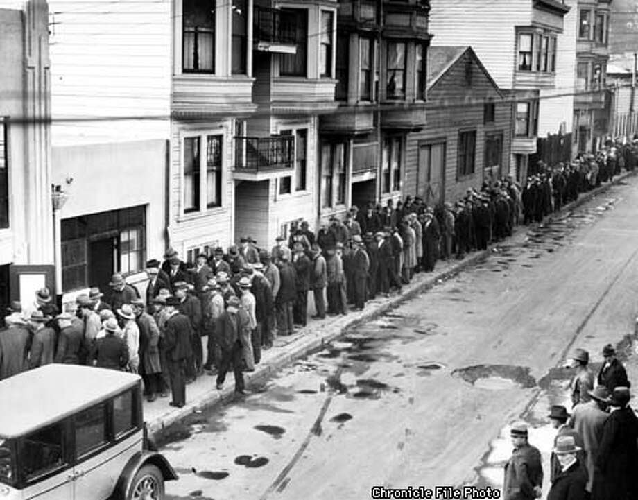 "Line up in front of ""the kitchen"", Clara and Ritch streets, where 2000 unemployed men are being fed twice daily. Unless jobs are provided through the passage of the $2,500,000 employment bonds at the special election, Feb. 6, 1931, thousands of additional San Franciscans out of work will be added to the ""breadline"". PHOTO BY R. HASS, JR."
