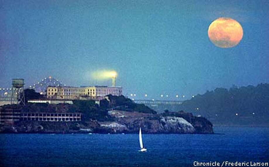 : Alcatraz Island in the San Francisco Bay was highlighted by the full morning Friday evening 4/30. Chronicle photo by Frederic Larson Photo: FREDERIC LARSON