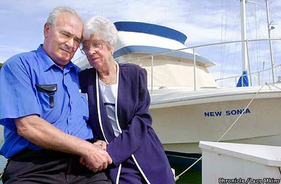 """Left to right--- Bonny and wife Marty Almeida along side of their 45 foot Chris Craft at the San Francisco Yatch Harbor, Sunday April 9,01. They loaned their boat """"New Sonia"""", to a man who after 8 months left it """"trashed"""".  Photo By Lacy Atkins/San Francisco Chronicle Photo: Lacy Atkins"""