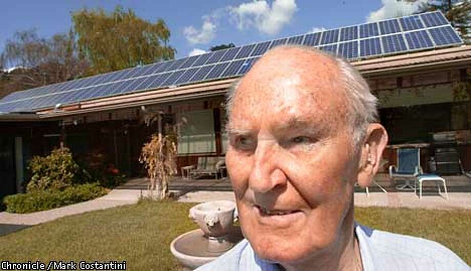 JOHNSON10a-C-09APRIL01-EZ-MC. Bob Hansen has no shortage of juice even though he's 83. He makes his own electricity with a bank of solar generators atop his roof(in background) that is converted to AC-DC and stored on batteries on a shed near his swimming pool, which is powered by the sun. Photo: Mark Costantini/S.F. Chronicle Photo: MARK COSTANTINI