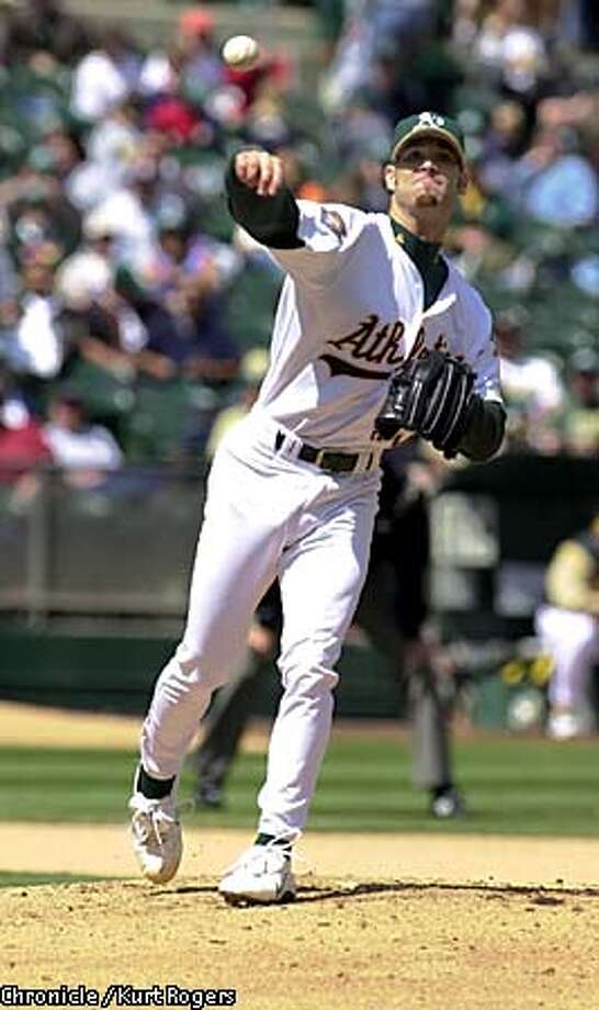 A's pitcher Tim Hudson limited Anaheim to three hits in eight innings and he extended his regular-season winning streak to eight games. Chronicle photo by Kurt Rogers