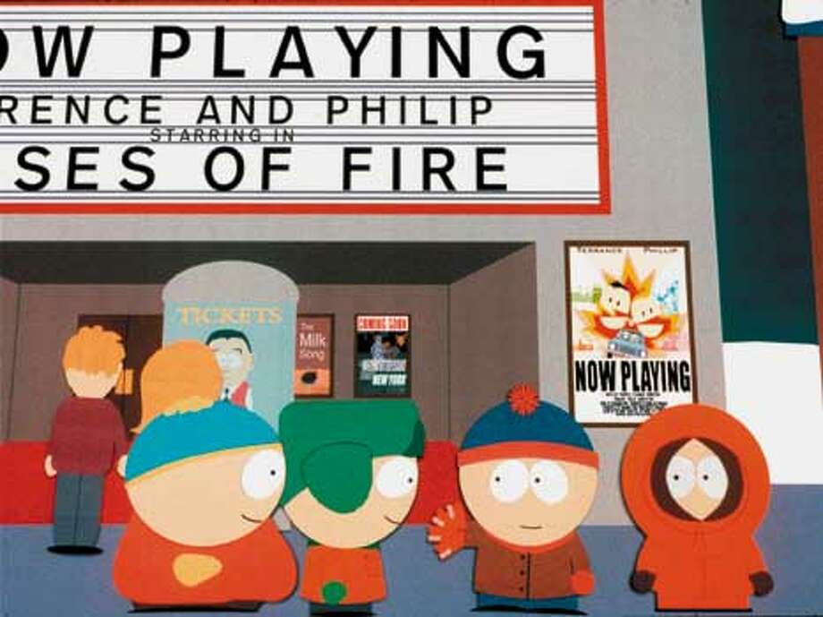 """The kids from South Park, from left, Cartman, Kyle, Stan, and Kenny, stand in front of a movie theater in this scene from Paramount Pictures and Warner Bros.' new full-length animated feature """"South Park: Bigger, Longer, & Uncut,"""" which opens in theaters June 30, 1999. (AP Photo/Paramount Pictures)"""