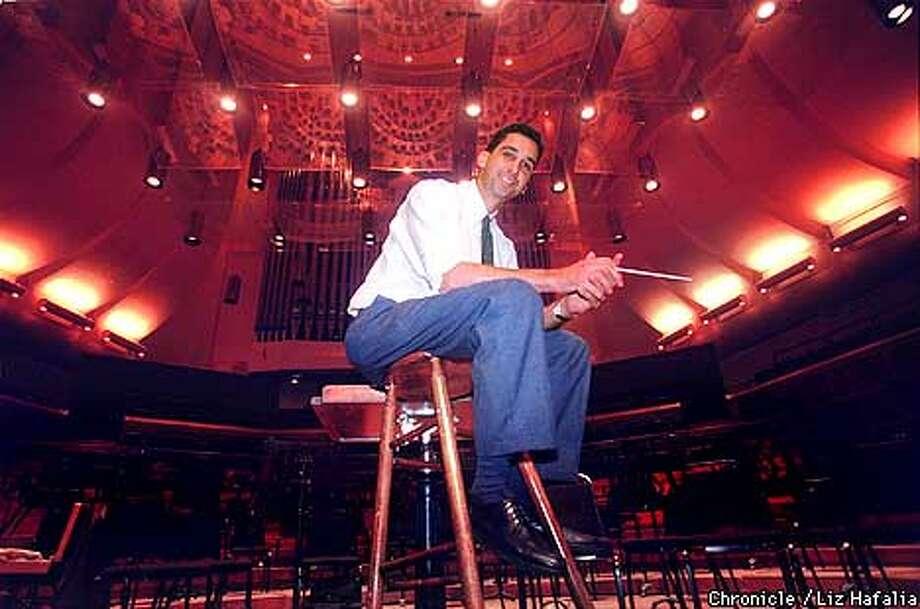 Emil De Cou will leave after the Paris tour next month. Chronicle photo, 1995, by Liz Hafalia