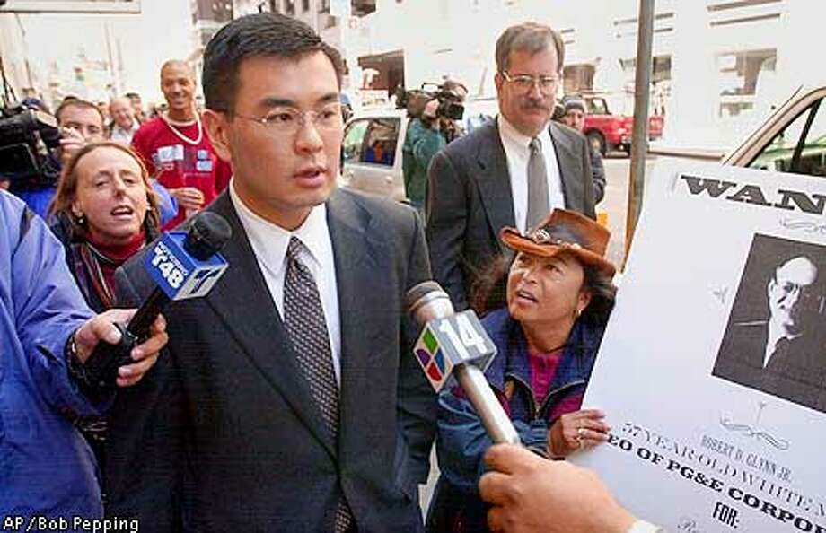 "Pacific Gas and Electric spokesman Ron Low is surrounded by protesters and the media after a banckruptcy hearing Monday, April 9, 2001, in Federal Bankruptcy Court in San Francisco. The protesters shouted questions about large bonuses being granted by the company just before going to bankruptcy court. PG&E, which filed for Chapter 11 protection last Friday, asked U.S. Bankruptcy Judge Dennis Montali to issue a temporary restraining order against the state Public Utilities Commission, a request that PUCGeneral Counsel Gary Cohen called a ""declaration of war"" against the commission and its authority to regulate the utility. (AP Photo/Contra Costa Times, Bob Pepping) Photo: BOB PEPPING"